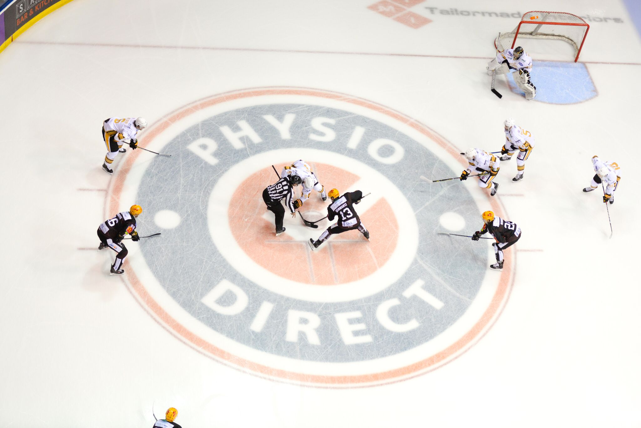 Nottingham Panthers ice hockey players standing on the PhysioDirect logo to show the PhysioDirect partnership with the Nottingham Panthers
